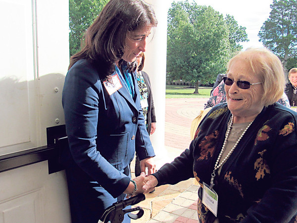 CATHY SPAULDING/Muskogee Phoenix<br /> Bacone College Vice President of Development Jan Peppler, left, greets Barbara Rossi of the Midewin Prairie Chapter of the Daughters of the American Revolution before a Wednesday gathering at Bacone Chapel. More than 50 members of various Illinois chapters of National Society of the Daughters of the American Revolution visited Bacone College. At Bacone, the delegation was greeted by representatives of Oklahoma DAR chapters, as well as Bacone officials. According to a media release, Illinois chapters of DAR donated almost $40,000 for new kitchen equipment for Bacone's new dining hall. Members of the Peoria chapter donated scholarship money for three Native American students. The delegation also had planned to visit the Spirit of the American Doughboy statue at the Jack C. Montgomery VA Medical Center.