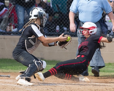 VON CASTOR/Phoenix special photo<br /> Hilldale's Makayla Williams slides into home ahead of the tag to score one of the Hornets' two runs on Wednesday during the Class 4A fastpitch semifinals in Shawnee. Hilldale lost to Tuttle 6-2.