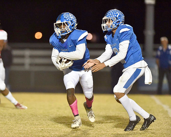 JIM WEBER/Phoenix Correspondent<br /> Checotah's Jacob Barrett, right, hands off to Dontairre Fisher during the Wildcats' game Thursday against Idabel. Checotah won 39-7.