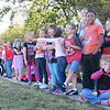 Staff photo by Cathy Spaulding<br /> Creek Elementary students point and gasp while watching a balloon inflate Wednesday morning.