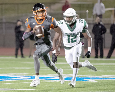 SHANE KEETER/Special to the Phoenix Muskogee's Caleb Webb runs after Tulsa Washington's Gentry Williams during Thursday's game at S.E. Williams Stadium. The Roughers lost 47-26.