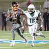 SHANE KEETER/Special to the Phoenix<br /> Muskogee's Caleb Webb runs after Tulsa Washington's Gentry Williams during Thursday's game at S.E. Williams Stadium. The Roughers lost 47-26.
