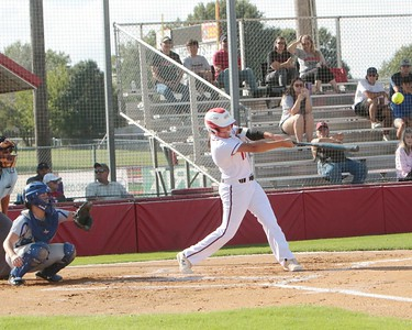 JOHN HASLER/Special to the Phoenix Hilldale's Addy Wolfe hits a sac fly in the bottom of the sixth to give the Lady Hornets the lead Monday.