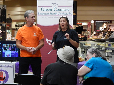KENTON BROOKS/Muskogee Phoenix Lynne Webster, right, and Bob Havens of Boulevard Christian Church's Celebrate Recovery program talk about how they help victims of domestic violence at Monday's kickoff event of Domestic Violence Awareness Month at Arrowhead Mall.