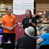 KENTON BROOKS/Muskogee Phoenix<br /> Lynne Webster, right, and Bob Havens of Boulevard Christian Church's Celebrate Recovery program talk about how they help victims of domestic violence at Monday's kickoff event of Domestic Violence Awareness Month at Arrowhead Mall.