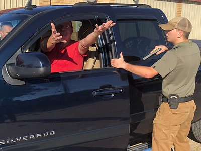 CHESLEY OXENDINE/Muskogee Phoenix Reserve officer in training David Woody, right, commands driver Charlie Roller to keep his hands outside of the vehicle during a mock traffic stop in Fort Gibson.