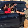 CHESLEY OXENDINE/Muskogee Phoenix<br /> Reserve officer in training David Woody, right, commands driver Charlie Roller to keep his hands outside of the vehicle during a mock traffic stop in Fort Gibson.