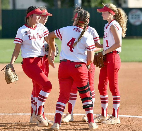 JIM WEBER/Phoenix Special Photo From left, Courtney Hill, Abbye Porterfield, McKenna Cantrell, Graci Williams (shadowed in middle) and Maycee Young gather in the infield during a break in action Tuesday.