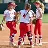 JIM WEBER/Phoenix Special Photo<br /> From left, Courtney Hill, Abbye Porterfield, McKenna Cantrell, Graci Williams (shadowed in middle) and Maycee Young gather in the infield during a break in action Tuesday.