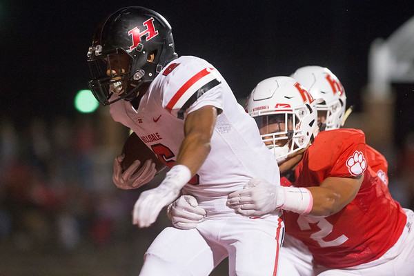 Phoenix special photo by Von Castor<br /> Hilldale's Devin Hembry breaks the tackle of Fort Gibson's Elijah Wright to score the winning touchdown in overtime Thursday night at Fort Gibson. The Hornets won 27-24.