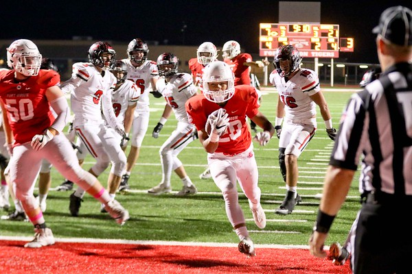 Phoenix special photo by John Hasler<br /> Fort Gibson's Jesse Rudd, center, breaks through Hilldale's defense for a four-yard touchdown, cutting the Tigers' deficit to 21-14 with 9:08 to play in the fourth quarter. Fort Gibson tied the game on another TD by Rudd but fell to Hilldale 27-24 in overtime.