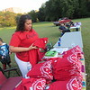 BrandyAnn Brior folds T-shirts during an Indigenous People's Day concert. She said she is learning more about her Cherokee heritage.