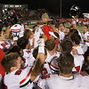 Special photo by Von Castor<br /> Hilldale Hornets hoist the Red-White Rumble Rock and celebrate an overtime win over Fort Gibson on Thursday to move into position to win District 4A-4.