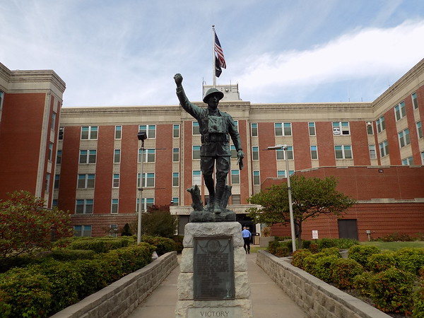 """Staff photo by Mike Elswick<br /> For more than 90 years the bronze statue depicting a World War I doughboy"""" soldier has been a mainstay at the Jack C. Montgomery VA Medical Center."""