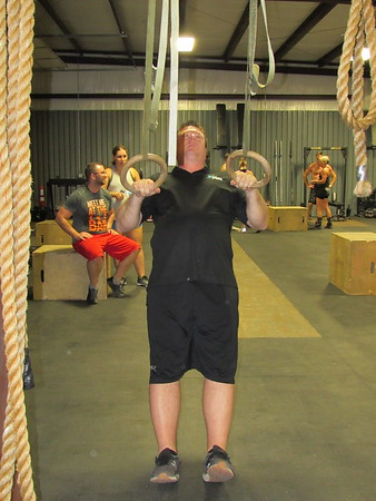 CATHY SPAULDING/Muskogee Phoenix<br /> Robert Allen pulls himself up on rings during a CrossFit exercise session. He said the daily workouts have helped him live a healthier lifestyle.
