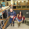 CATHY SPAULDING/Muskogee Phoenix<br /> Captain America (Andy Massie, left) and Wonder Woman (Arlene Lee) go up the stairs at Muskogee Public Library for the library's Muskogee Minicon, held Saturday. The event drew dozens of people for game tournaments, panels, comic book exhibits and a cosplay contest, in which people dressed up as TV, comic book, movie or video game characters.