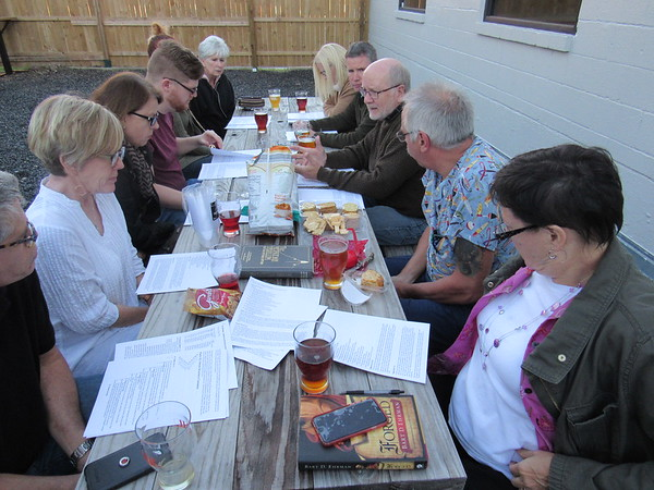 CATHY SPAULDING/Muskogee Phoenix<br /> Adult students gather for a Theology Pub Bible study Wednesday at The Rail Taproom. Previous studies have been at Pecan Creek Winery, and future studies will be at Station 1.