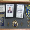 Staff photo by Cathy Spaulding<br /> A shadow box on Guy Parrish's office at LifePoint Church holds mementoes from his time as police chaplain in Texarkana, Arkansas. He also was pastor of First Assembly of God there.