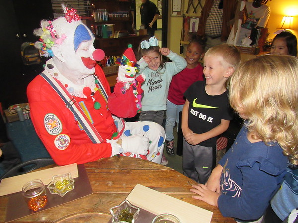 CATHYSPAULDING/Muskogee Phoenix <br /> Hi-Bi the clown scolds his hand puppet for pecking at Early Childhood Center pupils, from left, Brynleigh Gaghin, Peyton Wilson Gabrial Clarke and Khloe Synar. Hi-Bi and other Bedouin Shrine Clowns visited ECC and other schools to hand out free Shrine Circus tickets.