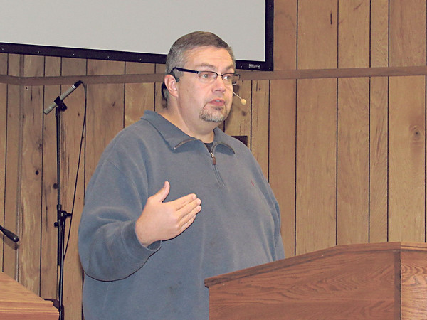 CATHY SPAULDING/Muskogee Phoenix<br /> Nate Capps, interim pastor at Fort Gibson's First Baptist Church delivers a point during a Wednesday evening Bible Study. He finds time to minister to his congregation, even with a second job as a pediatric paramedic.