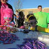 Staff photo by Cathy Spaulding<br /> A pinkhaired troll, Makenzie Hall, 5, and her Minion sister, Makenlie Hall, 5, have lots of candy to choose from at the Connors State College Fall Festival. Connors State College invited children to try their skill at  games Monday afternoon at the Muskogee Campus fall festival. Every youngster got a treat, however.