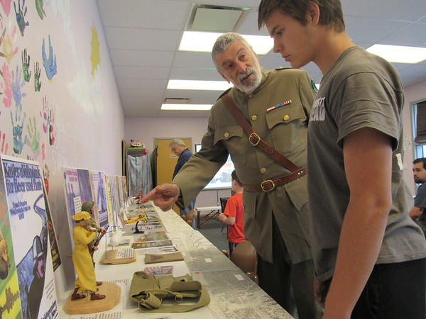 Staff photo by Cathy Spaulding<br /> World War I lecturer and retired librarian John Hinkle, left, shows  Tystan Turpin items related to the war. Hinkle discussed the war's effects  Friday at Q.B. Boydstun Library.