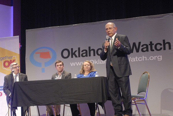 D.E. SMOOT/Muskogee Phoenix<br /> Democratic nominee Jack Reavis, right, stakes out a position on issues raised Tuesday during a candidate forum at the Roxy Theater. Also pictured, from left, are David Fritze, executive editor of Oklahoma Watch, House District 13 Rep. Avery Frix, R-Muskogee, and his Democratic challenger Jolene Armstrong.