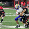 SHANE KEETER/Special to the Phoenix<br /> Hilldale defender Michael Oeser wraps up an Oologah ball carrier while Trace Ford pursues. Hilldale's defensive chore this week is to stop the Fort Gibson run game.