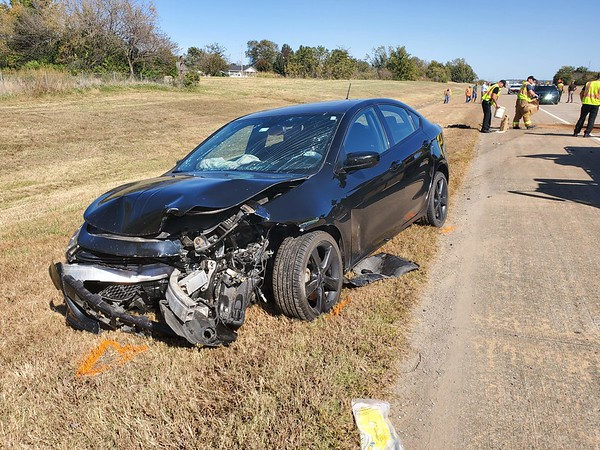 """CHESLEY OXENDINE/Muskogee Phoenix<br /> A driver, whose name was not released, collided with a temporary city worker at approximately 2 p.m. Wednesday while the worker was mowing the center median on Peak Boulevard near Country Club Road. The crash occurred when the driver of the Dodge Dart hit the tractor from behind when the tractor had moved onto the roadway to travel elsewhere, said Oklahoma Highway Patrol Trooper Randy Cox. """"The mower was in the left lane going somewhere else to mow and as far as we can tell, the kid was distracted by something in the car and hit the mower from behind,"""" Cox said. Both drivers were taken to Saint Francis Hospital Muskogee to be treated for minor injuries."""