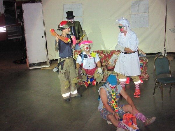 CATHY SPAULDING/Muskogee Phoenix<br /> Muskogee Firefighter Taylor Etchison warns the clown Franken Beans (Jefferson Bowman), right, about the dangers of playing with matches, one of the lessons Muskogee Fire Department Local 57 clowns taught during a comic performance Wednesday at Muskogee Civic Center. Other clowns were, from second left, Blisters (Evan Wallace), Fire Marshal Buzz (Joe Croftcheck) and Hee Haw (Kevin Cook). The clowns presented humorous fire safety lessons Wednesday to Hilldale Elementary students, including how to set a smoke detector and what to do if there is a fire.