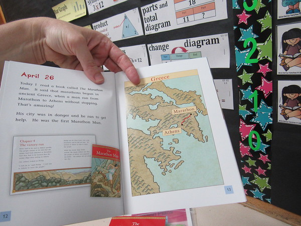 Staff photo by Cathy Spaulding<br /> Joni Martin's new books have maps, graphs and other supplemental features to help students retain information from what they read.