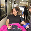 CATHY SPAULDING/Muskogee Phoenix<br /> Jennifer Kizzia, left, looks away while Oklahoma Blood Institute phlebotomist Sarah Holloway inserts a needle to withdraw blood during a Wednesday blood drive at the Wal-Mart parking lot. The OBI worked two blood drives Wednesday. One was sponsored by the Muskogee Hotel and Lodging Association and was held in the Wal-Mart parking lot. The other was held at the Muskogee High School Fine Arts auditorium, an OBI spokeswoman said.