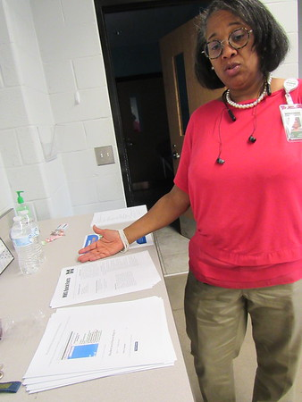 CATHY SPAULDING/Muskogee Phoenix<br /> Lori Jefferson shows some of the information she hands out at Muskogee Public Schools Parent University sessions. The next sessions will be Nov. 19.
