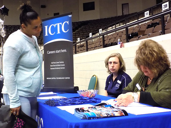Staff photo by Mike Elswick<br /> Daja Drew, left of Muskogee, was among attendees Wednesday at the Eastern Oklahoma Workforce Board and Cherokee Nation sponsored business and resource fair. She is seen visiting with Brandi Dunback, center, and Gayle Ingram, both with Indian Capital Technology Center. The event offers the public the opportunity to get employment  information and discover resources of area nonprofit organizations.