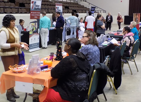 Staff photo by Mike Elswick<br /> More than 40 area businesses and nonprofit organizations were set up Wednesday at Muskogee Civic Center to offer attendees information at the business and resource fair hosted by the Eastern Oklahoma  Workforce Board and Cherokee Nation. The event was held at Muskogee Civic Center.