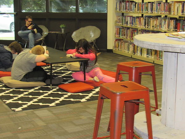 CATHY SPAULDING/Muskogee Phoenix<br /> Students have a variety of seating and study options at the Hilldale High School/Middle School Library. They include floor cushions and a cable spool repurposed as a table.