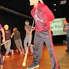 "CATHY SPAULDING/Muskogee Phoenix<br /> Michael Wright of Porum works his way around the Fort Gibson High School stage while wearing pantyhose, with a tennis ball in the toe. He and other middle school/junior high students tried using the pantyhose/tennis ball ""hats"" to knock similar hats off opponents' heads during Boys Bash, held Thursday. Boys from 12<br /> area middle schools and junior highs attended the Boys Bash. Speaker Steve Moss, family minister at Boulevard Christian Church, told boys to value and respect girls and women. He gave them safe dating tips, such as go in groups, avoid dark places and sit up."