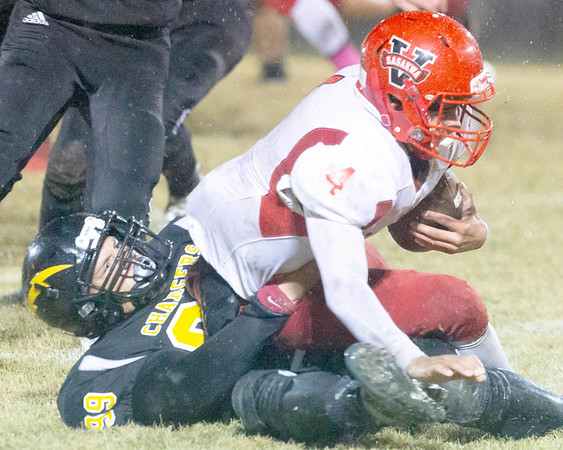 VON CASTOR/Special to the Phoenix<br /> Midway's Leslie Howard tackles Sasakwa's Thomas Rompf for a big loss during second quarter action Friday night at Council Hill. The Chargers lost 32-28.