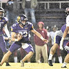 JIM WEBER/Special to the Phoenix<br /> Vian's Gray Cloud, left, looks for a hole in the Holland Hall defense during Friday's game in Vian. The Wolverines won 49-16.