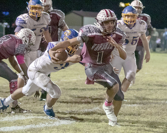SHANE KEETER/Special to the Phoenix<br /> Eufaula's Nick Jones overcomes an attempted tackle by Antlers' Zion Wood to break away for a sizeable gain during the Ironhead's 19-2 win on Friday in Eufaula.