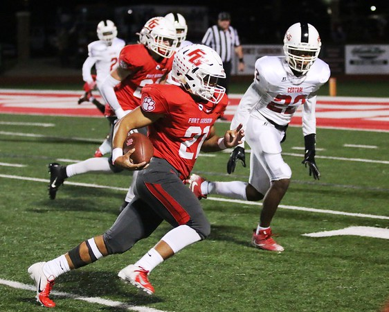 JOHN HASLER/Special to the Phoenix<br /> Fort Gibson's Tavien Woodworth gets around the Tulsa Central defense for a big gain on Friday at Leo Donahue Tiger Stadium.