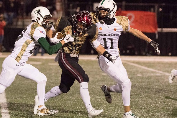 Phoenix special photo by Abigail Washington<br /> Wagoner's Steven Adair gets through the Catoosa defense to gain 22 yards during the Bulldogs' 39-9 win on Friday.
