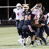 Phoenix special photo by John Hasler<br /> Fort Gibson's Hunter Lawson, center, intercepts a pass during the Tigers' 30-0 win over Sallisaw on Friday.