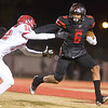 Phoenix special photo by Von Castor<br /> Hilldale's Devin Hembry breaks the tackle of Stilwell's Caleb Chuculate to score his second touchdown of the game Friday night at Hornet Stadium.