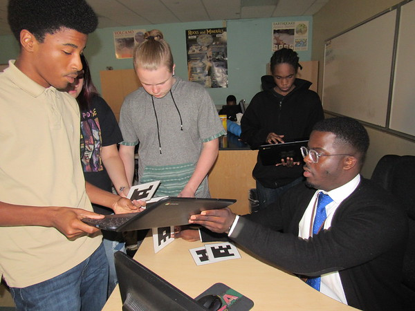 Staff photo by Cathy Spaulding<br /> Muskogee High School earth science teacher Ja'Corie Maxwell reviews assignments for students. Maxwell said he expects consistency in his classroom.