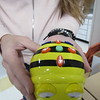 A Bee-Bot can be programmed to go forward, backward, left or right. It helps youngsters learn computer coding.