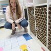 CATHY SPAULDING/Muskogee Phoenix<br /> Fort Gibson Early Learning Center STEAM Lab instructor Catherine Hardy watches a Bee-Bot move on a programmed path. She received a Fort Gibson Education Foundation grant for two more robots.