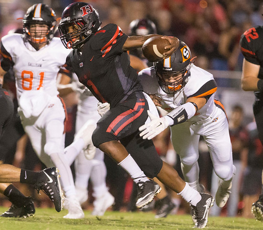 Phoenix special photo by Von Castor<br /> Hilldale's Mikey Winston, shown here against Sallisaw, rushed for two TDs last Friday against Broken Bow. The Hornets are tied with arch-rival Fort Gibson atop the District 4A-4 standings.