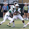 SHANE KEETERPhoenix special photo<br /> Muskogee quarterback Ty Williams, right, hands off to Jimmie Coleman. The two accounted for most of the nearly 500 yards the Roughers got in last week's 45-27 win against Sand Springs.