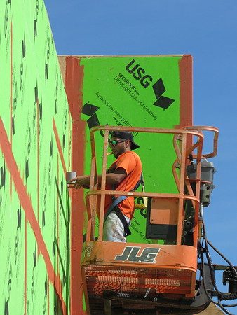 CATHY SPAULDING/Muskogee Phoenix<br /> A worker prepares a facade for stucco while working on Burkes Outlet's exterior Wednesday at 2230 E. Shawnee Bypass. Burkes Outlet, an outlet store for name brand clothing and items, is scheduled to open in mid-November, at Shawnee Crossing (formerly Curt's Center), said contractor Larry Henley of Harrison, Arkansas.